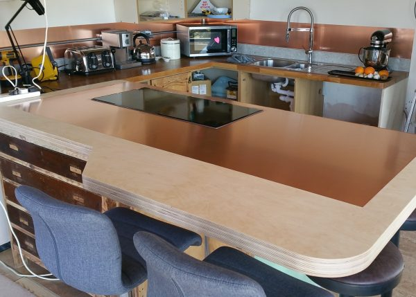copper kitchen counter top and copper splashback