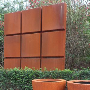 corten steel panel featuring 9 blocks, measuring 1950mm x 100mm x 1950mm, placed outdoors as a garden feature