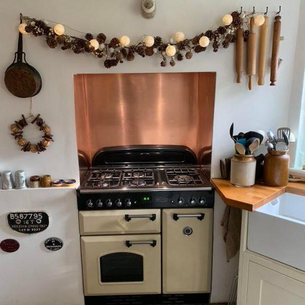 new copper kitchen splashback in rustic kitchen