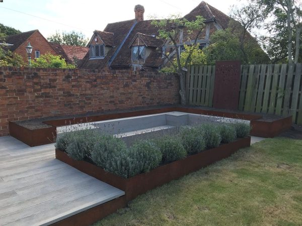 corten steel edging used for flower beds around seating area