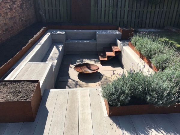 corten steel edging used for raised beds around seating area