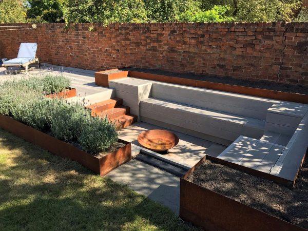 corten steel seating area in garden