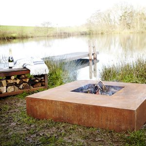 square outdoor fire table measuring 1250mm x 280mm made from corten steel, also called fire pit