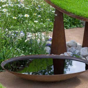 corten steel garden water bowl filled with water