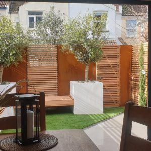 corten steel used used as panels in a modern garden design
