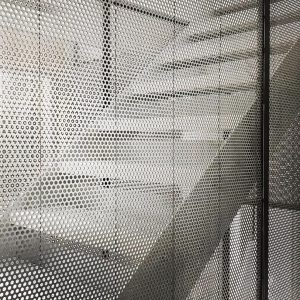 round hole perforated sheet metal used either side of staircase