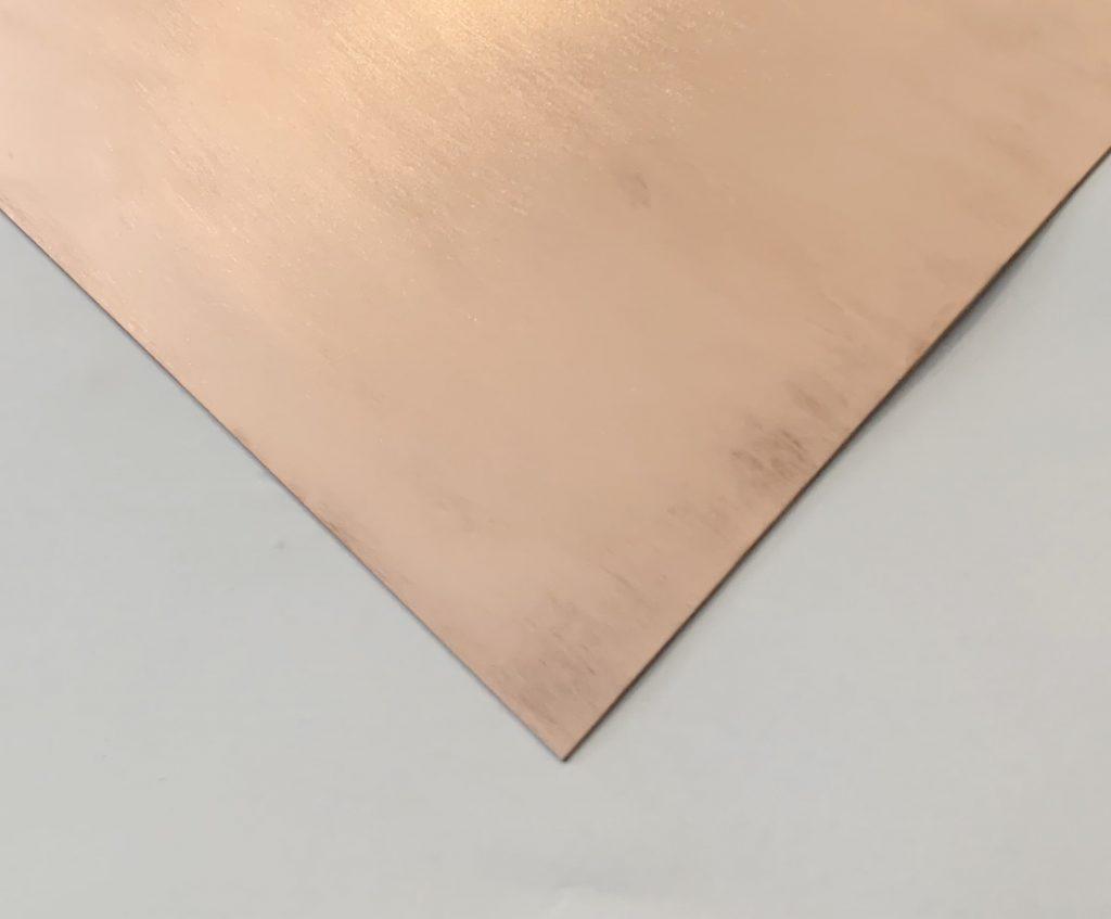 brushed copper sheet on white background