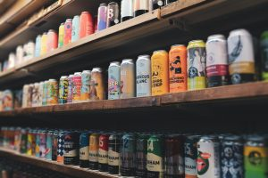 aluminium beer cans on shop shelf